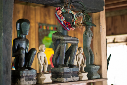 statues at the Native Village Inn