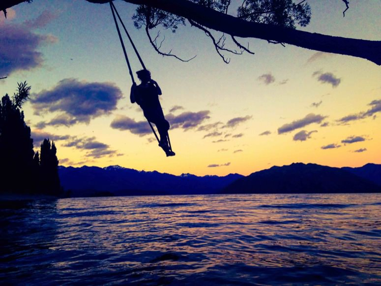 On a swing at sunset