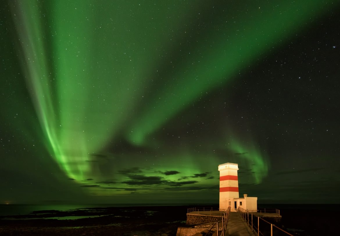 This isn't your standard lighthouse light, but hey, I think I prefer it to a simple white flashing beam! Captured at the old lighthouse at Gardur on the Reykjanes penunsula of Iceland.